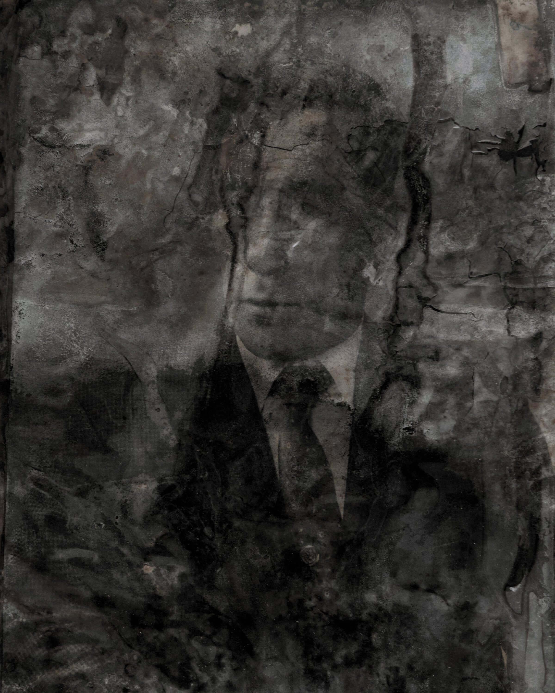 Portret mężczyzny wgarniturze.
